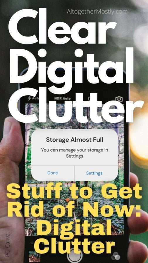 clear digital clutter text over a smart phone with a warning that the digital storage is almost full